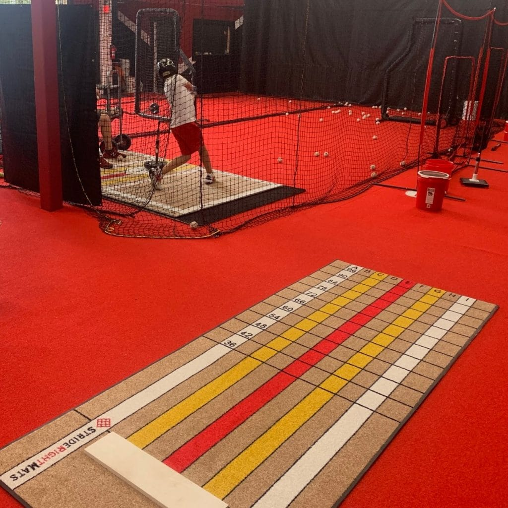 Elite Pitching Mat Plus Elite Hitter on Red Turf Facility